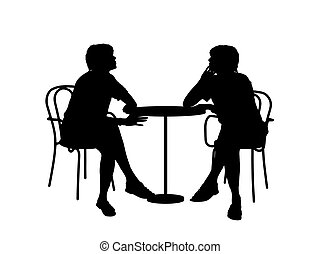 two women sitting at the table