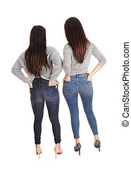 Two women standing from the back in jeans