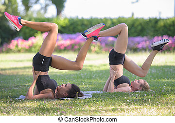 two women stretching during fitness workout