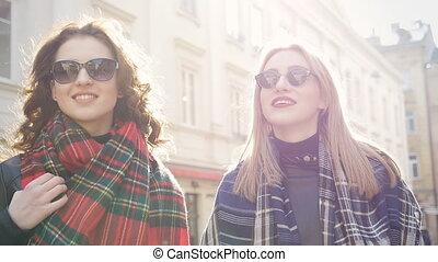 Two women walking in the city, steadicam shot
