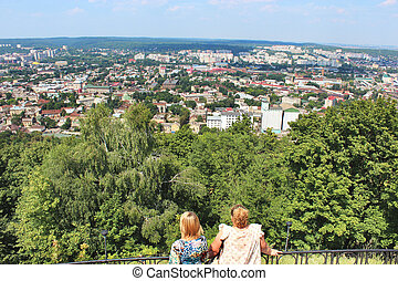 two women watching to the open space above Lvov city