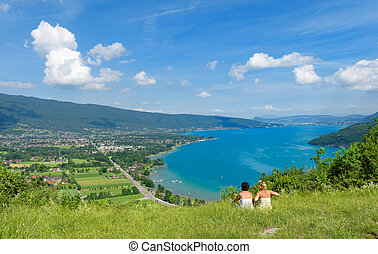 Two women watching view of Lake Annecy