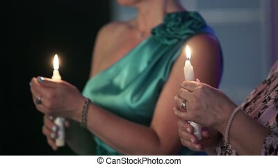 Two women with candles in hands