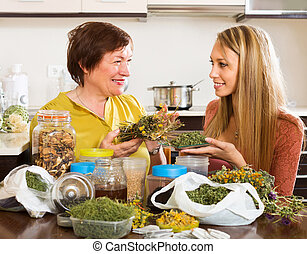 Two women with dried herbs