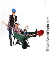 Two women with wheelbarrow