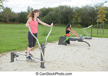 Two women working out in park