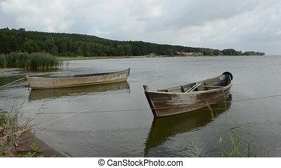 two wooden boats near coast