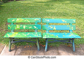 Two wooden chairs in a park