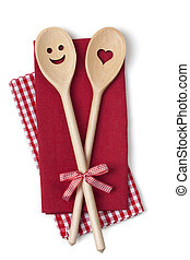 Two wooden cooking spoons on a red napkin