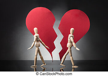 Two Wooden Dummy Standing Against Each Other With Broken...