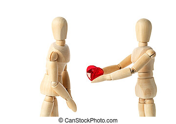 Two wooden figures of a dummy, give a red heart, isolated on a white background - pictures of the theme concepts Love and Valentine's Day.