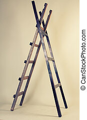 Two wooden ladders on a gray background
