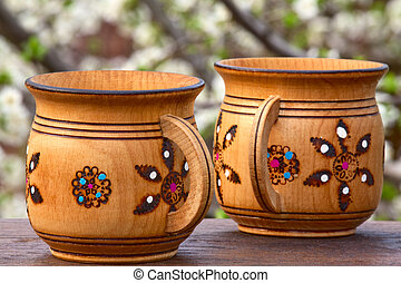 Two wooden mugs