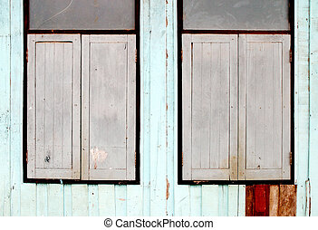 two wooden window on wooden wall