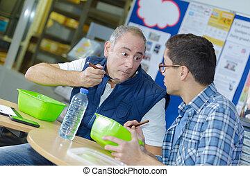 two worker in factory having a lunch break