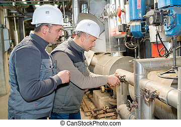 two worker in factory on the machine