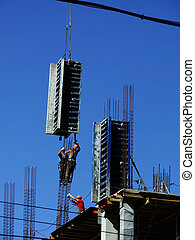 two worker mounter assembling concrete formwork at construction site