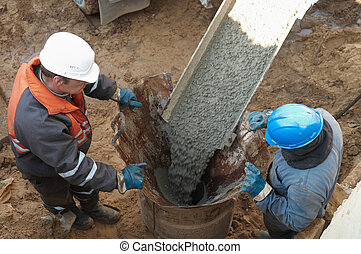two workers at piling - couple workers making pile form ...