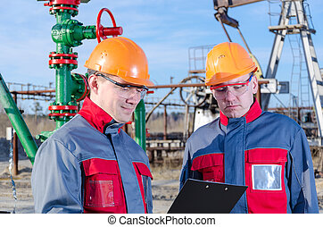 Two workers in the oilfield