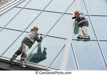 two workers installing outside window