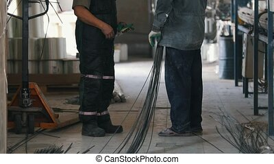 Two workers on plant of fiberglass reinforcement - explore...