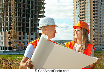 two workers on the building site