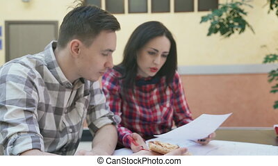Two workers woman man discussing business project in office.