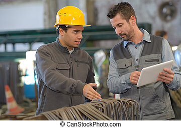 two workers working in a factory