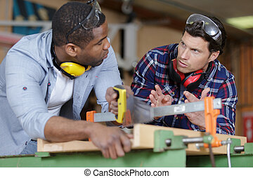 two workmen are at workshop