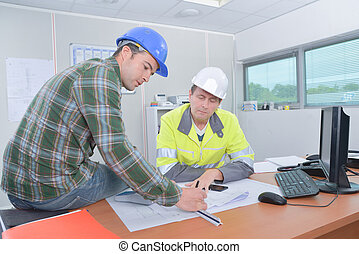 two workmen in the office
