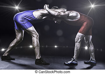 Two wrestlers in stance on stage - Two freestyle wrestlers...