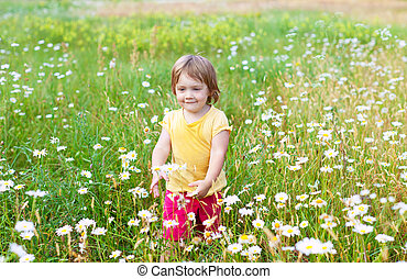 Two-year child in meadow