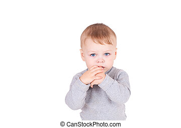Two years boy standing against the white background