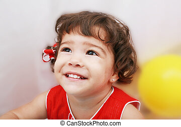 Two years old girl expressing happy over white background