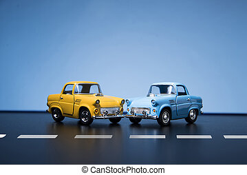 Two Yellow fifties toy model cars.