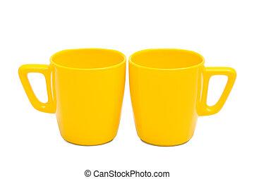 two yellow mug
