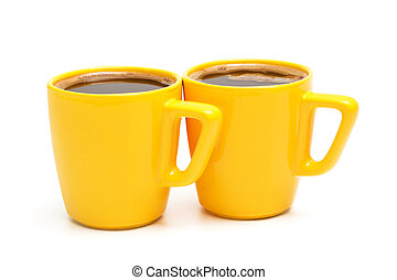 two yellow mugs
