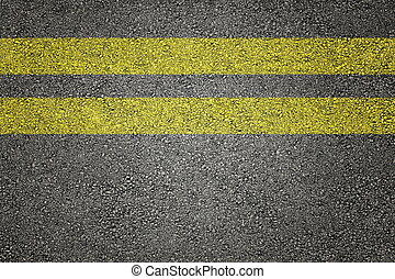 Two yellow stripes on asphalt