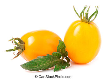 two yellow tomato with leaf isolated on white background