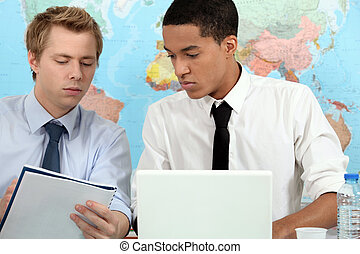 Two young adults preparing student presentation