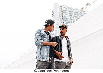 Two young african men friends walking