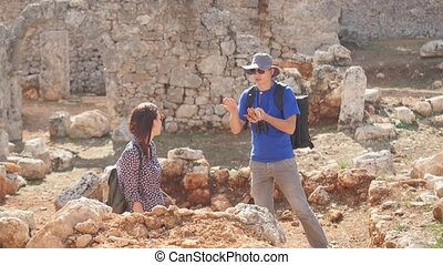 Two young archaeologists exploring ancient city - Two young...