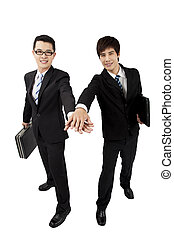 Two young asian   businessman with touch hands