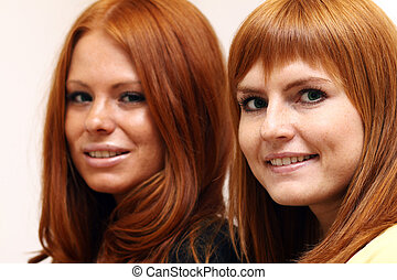 Two young beautiful redhead women