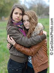 Two Young Beautiful Teen Girls friendly Hug