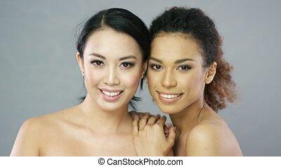 Two young beautiful women in studio