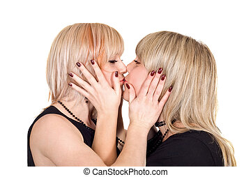 Two young beauty kissing blonde. Isolated on a white