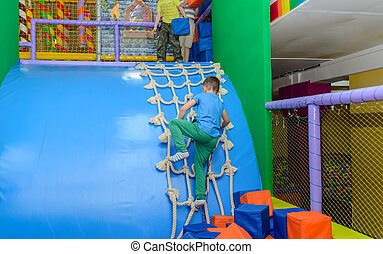 Two young boys playing in a kids playground