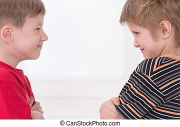 Two young boys standing face to face. Two teenage boys ...