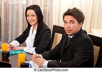 Two young business people at meeting